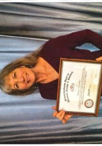 Margie Pic for NCBTMB with certificate